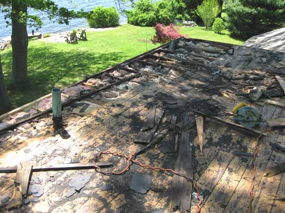 Rotten wood damage to decking and rafters on a flat roof in Andover, CT