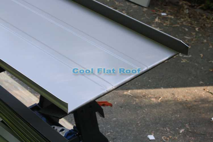 Flat Metal Roof Panel http://www.coolflatroof.com/flat-roofing-blog/standing-seam-metal-roof-installation-in-wayland-ma/