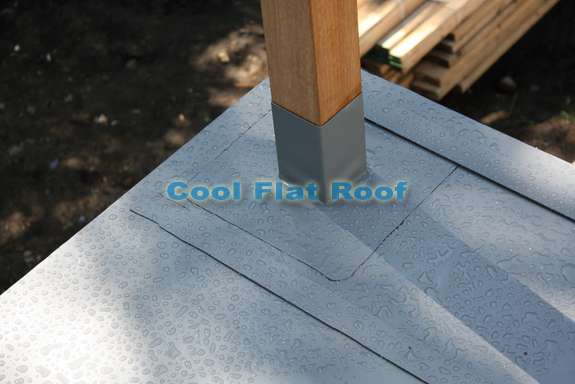 One-piece post flashing installed aroud railing posts and welded to IB Flat Roof