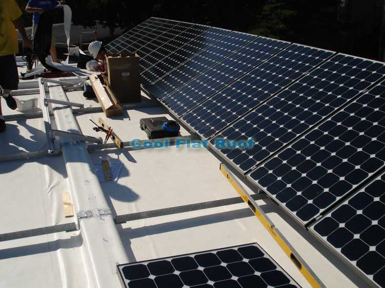 Flat Roof with Solar PV panels and Solar Hot Water