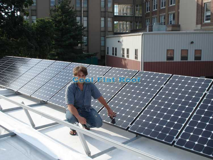 Leo on the roof of Boston Solar Home, after roof installation was completed.