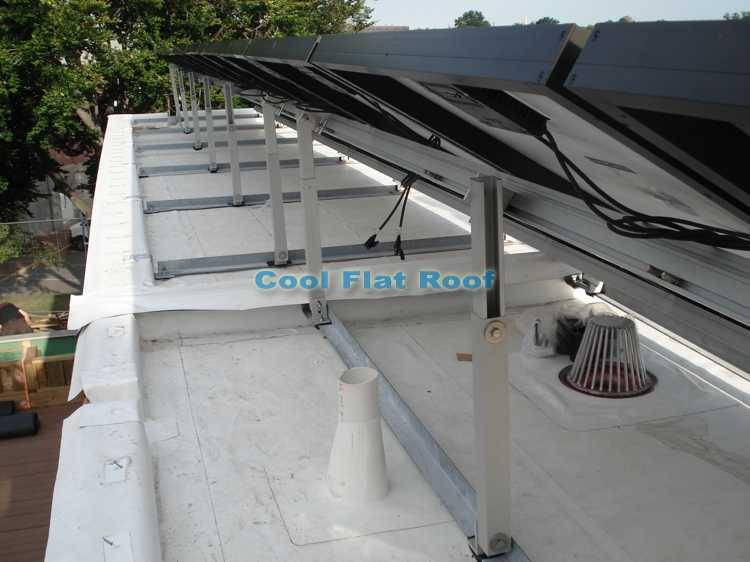 Solar Home Flat Roof: Solar PV panels, IB u-flow drain, overflow scupper and bathroom vent pipe flashing