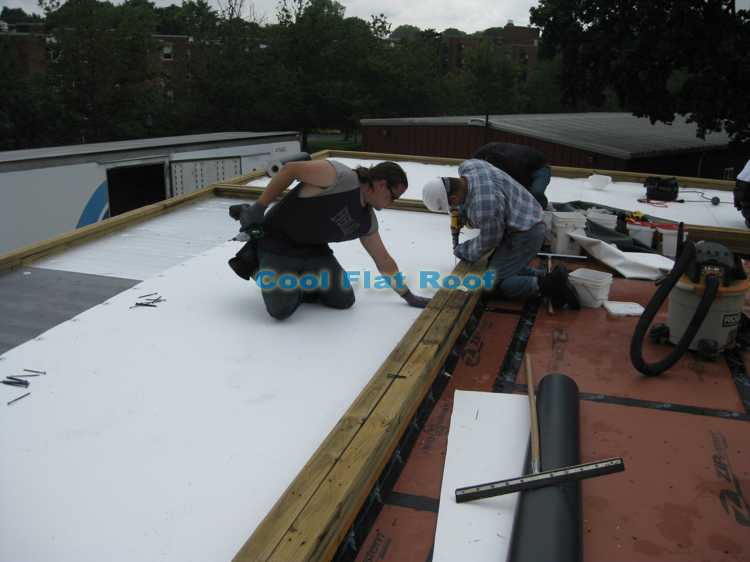 Installing IB PVC membrane an a roof of Boston Solar Home
