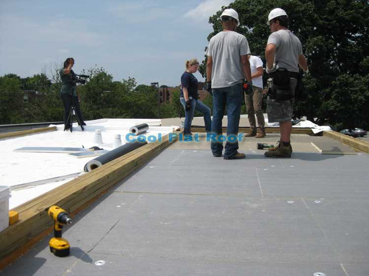Boston Solar Home: Insulation is installed and the last section of IB Flat Roof is ready to go on.