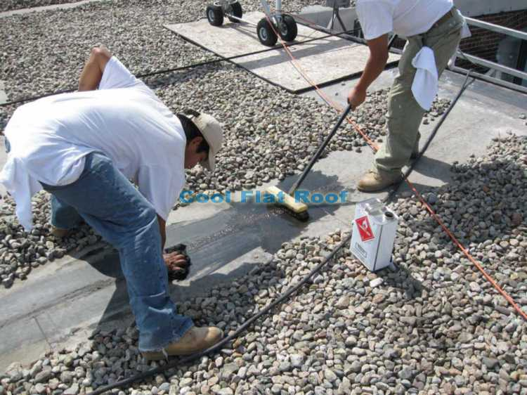 Cleaning the rubber roof seams with EPDM membrane cleaner
