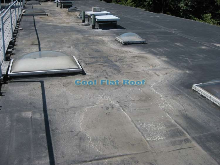 Ponding water on EPDM rubber roof in Brookline, MA.