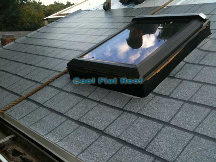 IB flat roofing membrane being installed on a low-slope roof in Hingham, MA