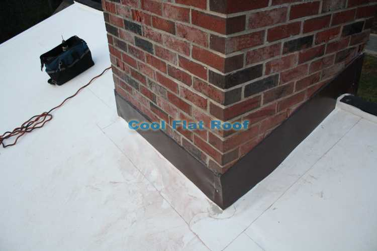 Chimney flashing on a flat roof in Wetminster, MA