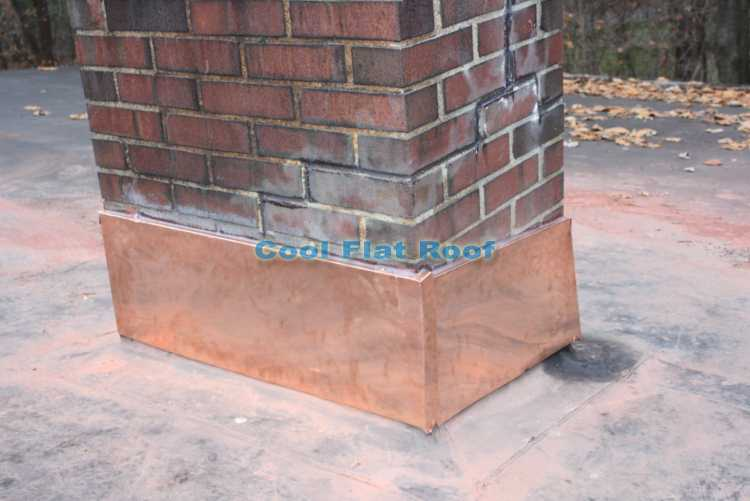 Rubber roof - chimney with copper flashing