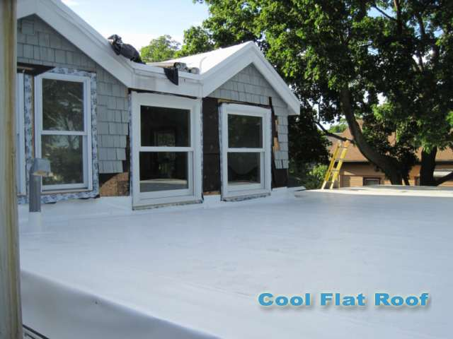 Image of IB PVC flat roof with tapered insulation eliminated ponding water on leaking rubber roof.