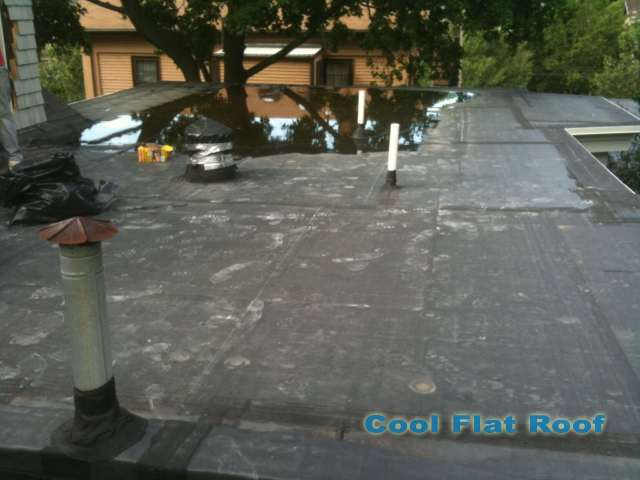 "Image of Leaking rubber roof with 2"" of ponding water."