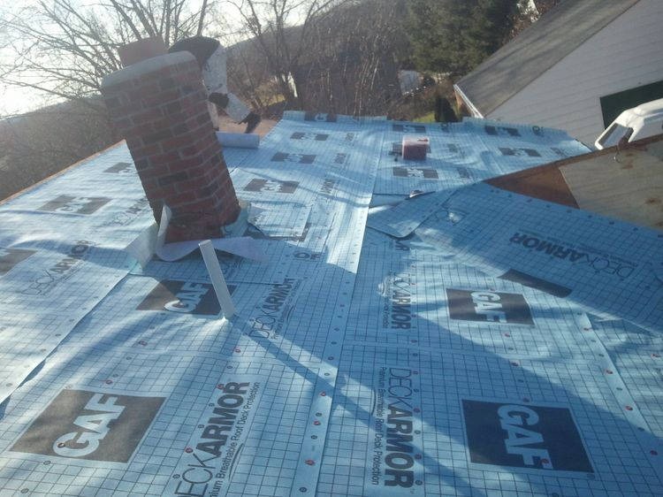image of Metal Roof - installing underlayment
