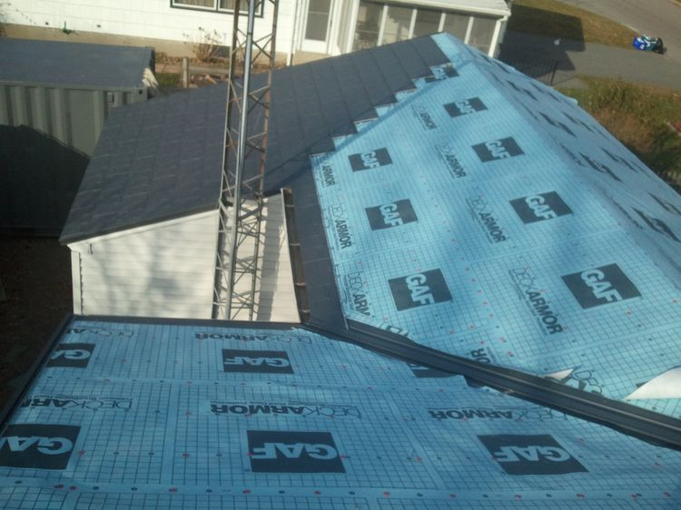 image of Metal Roof installation - flashing valley and installing metal shingles