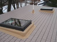 Arlington, MA residential flat roof addition and flat deck/roof - Beauty and uncompromising quality with IB Traditions Classic flat roofing membrane with an imprinted architectural shingle pattern.