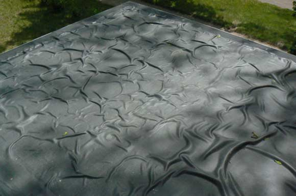 EPDM roof bubbles - what happens when a wrong adhesive is combined with wrong roofing membrane and a wrong installation method.