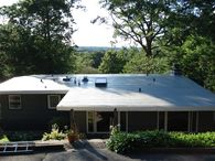 An 80-mil grey IB PVC flat roofing single-ply membrane installed in Wallingford, Connecticut.