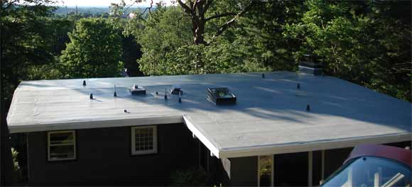 Residential IB Cool Roof in Wallingford, Connecticut. This 80-mil grey roof perfectly blends with the house, keeps the water out, and homeowners happy. No more patching or repairs, no more worries!