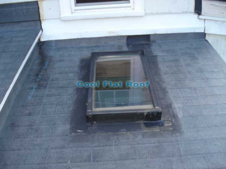 "flat rubber roof Quincy massachusetts"" title=""Leaking rubber roof in Quincy, MA. Roofing membrane was glued directly to asphalt shingles."